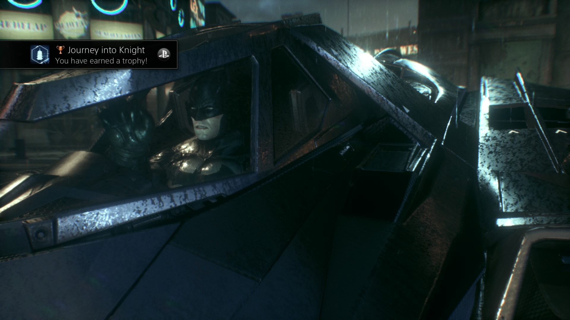 Batman stürzt sich in die Nacht. Natürlich stilvoll im Batmobil.
